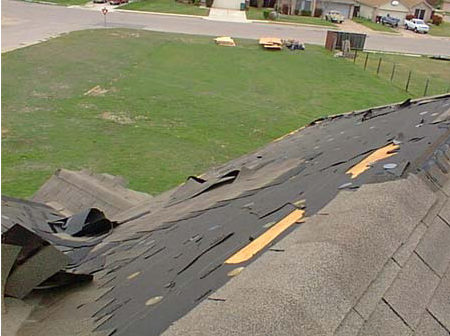 Roof with storm damage