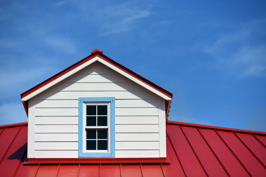 close up of a red roof detail house and a blue sky