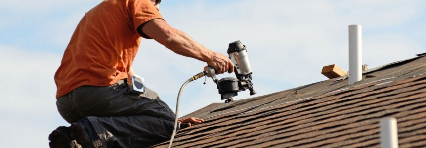 picture of man working on roof with a nail gun to represent best roofing company
