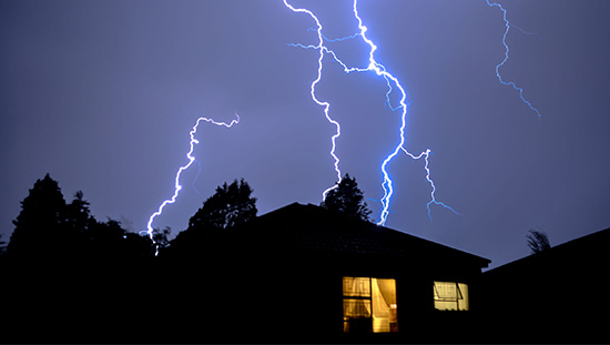 House with lightning in the background