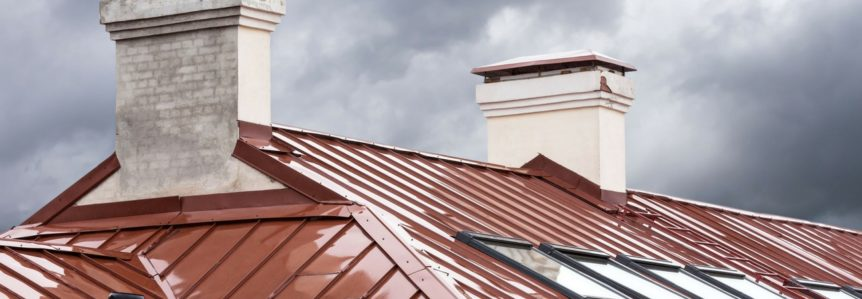 new metal roof on a house with a stormy sky - metal roofing