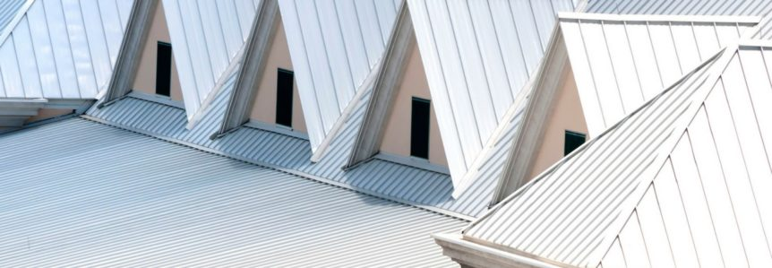 the top of a home with new steel grey metal roofing