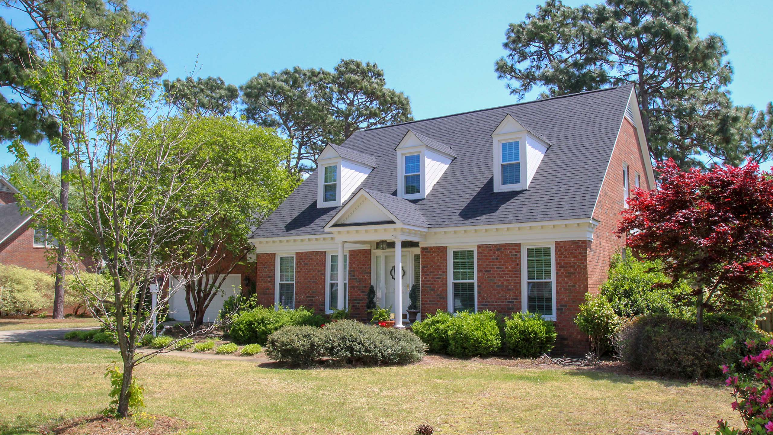 Cape style house with new shingle roofing home page